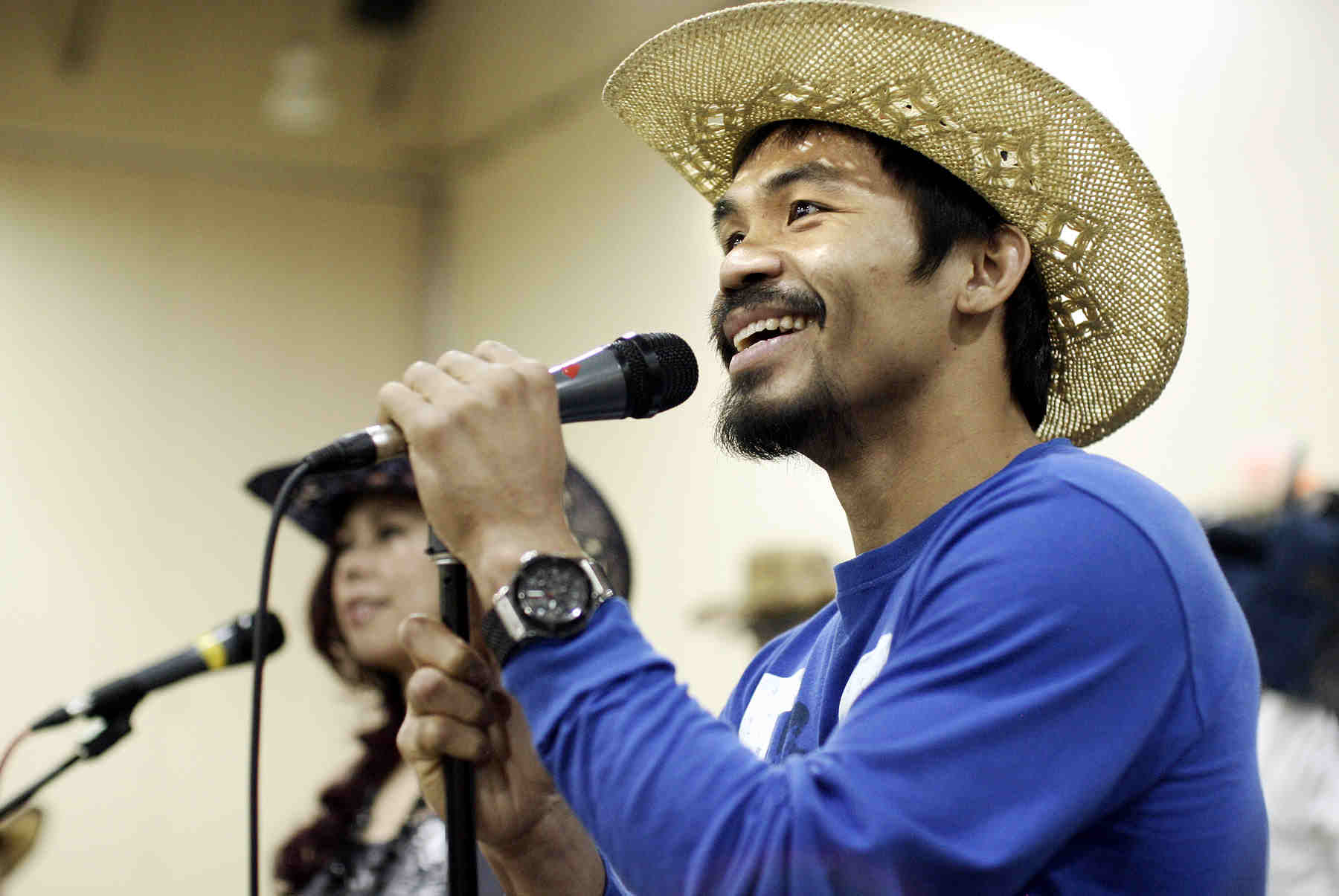 "Pacquiao Sues ""Wow Magic Sing"" Executives"